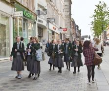 UK School students walking through outside mall - long woollen skirts on girls